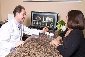 Dentist with patient explaining procedure