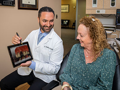 Dr. Ovadia educating a patient
