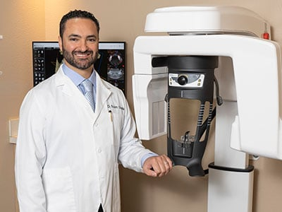 Dr. Ovadia with a CT scanner